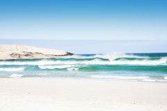 Beach with waves. Sunny day on South African beach with big waves and clear blue sky royalty free stock photos