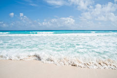 Beach and waves. Gentle white waves coming to a sandy beach Stock Photos