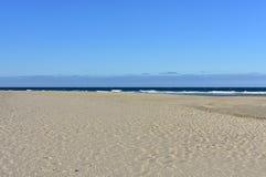 Beach with waves and blue sky. Galicia, Spain. Galicia, La Coruña Province, Rias Altas, Spain. Wild beach with waves. Sunny day, blue sky royalty free stock photos