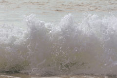 Beach waves crash towards the shore on a hot summer morning. Refreshing beach waves crash towards the shore on a hot summer morning royalty free stock images