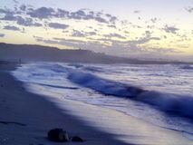 Beach. Waves at beach early morning sun cloud formations stock image