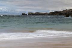 Beach with waves and without people. Beautiful beach with waves breaking on the shore and without people royalty free stock photography