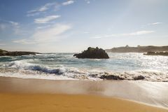 Beach with waves and without people. Beautiful beach with waves breaking on the shore and without people royalty free stock image
