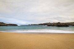 Beach with waves and without people. Beautiful beach with waves breaking on the shore and without people stock photo