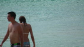 Beach waves. PHUKET, THAILAND - NOVEMBER 20, 2014: Unidentified tourists on the Karon beach, turquoise sea water waves, Andaman Sea stock video footage