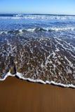 Beach with waves reaching mediterranean shore. Spain stock image