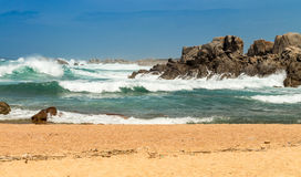 Beach with Waves and Rocks Royalty Free Stock Image