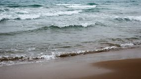 A beach and waves in the sea. Crete, Greece stock image