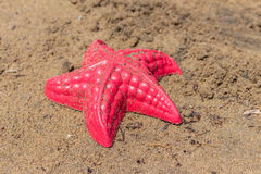 Beach Waves Starfish and colored toys Stock Photography