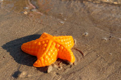 Beach Waves Starfish and colored toys Royalty Free Stock Images