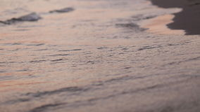 Beach waves at sunset stock footage