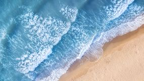 Beach and waves from top view. Aerial view of luxury resting at sunny day. Summer seascape from air. Top view from drone. Travel-image stock photos
