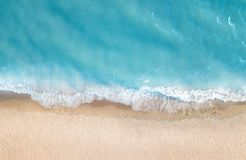 Beach and waves from top view. Summer seascape from air. Top view from drone. Beach and waves from top view. Aerial view of luxury resting at sunny day. Summer royalty free stock images