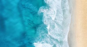 Beach and waves from top view. Turquoise water background from top view. Summer seascape from air. Top view from drone. Travel concept and idea stock photos