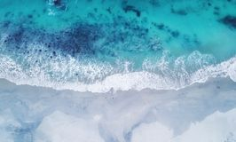 Beach and waves from top view. Turquoise water background from top view. Summer seascape from air. Top view from drone. Travel concept and idea royalty free stock image