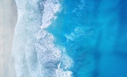 Beach and waves from top view. Turquoise water background from top view. Summer seascape from air. Top view from drone. Travel concept and idea stock photography
