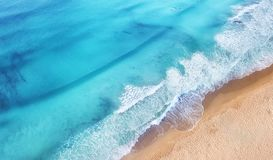 Beach and waves from top view. Turquoise water background from top view. Summer seascape from air. Top view from drone. Travel concept and idea royalty free stock photography