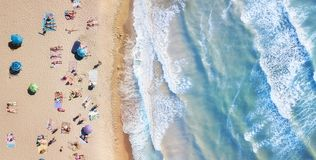 Beach and waves from top view. Turquoise water background from top view. Summer seascape from air. Top view from drone. Travel-image stock photos