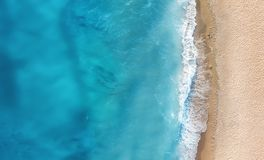 Beach and waves from top view. Turquoise water background from top view. Summer seascape from air. Top view from drone. Travel concept and idea stock photo