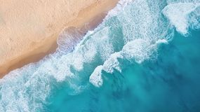 Beach and waves from top view. Turquoise water background from top view. Summer seascape from air. Top view from drone. Travel concept and idea stock images
