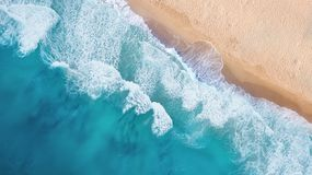Beach and waves from top view. Turquoise water background from top view. royalty free stock photography