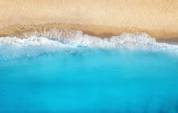 Beach and waves from top view. Turquoise water background from top view. Summer seascape from air. royalty free stock photography