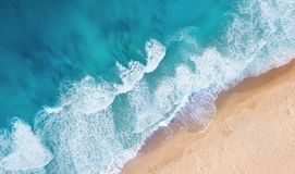 Beach and waves from top view. Turquoise water background from top view. Summer seascape from air. royalty free stock photo