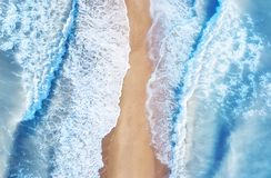 Beach and waves from top view. Turquoise water background from top view. Summer seascape from air. Top view from drone. Travel concept and idea royalty free stock images