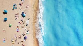 Beach and waves from top view. Turquoise water background from top view. Summer seascape from air. Top view from drone. stock image