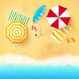 Beach with waves, umbrellas, bright towels and Royalty Free Stock Image
