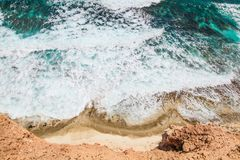 Beach, waves and water shot from above. On a sunny day Stock Photos