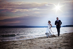 Beach wedding. Married couple on the beach in wedding outfits Royalty Free Stock Photo