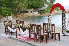 Beach wedding. Guest chairs and decorated setting for an outdoor beach wedding ceremony royalty free stock image