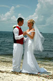 Beach wedding. A  happy bride and groom on the beach after wedding Stock Image
