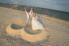 Beach wedding. Of happy newlywed couple royalty free stock photo
