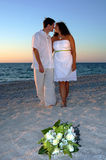 Beach wedding. A bride and groom on the beach after wedding at sunset Stock Photo