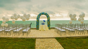 Beach wedding arch. Beach wedding set up, outdoor wedding reception, wedding arch Royalty Free Stock Images