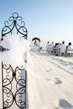 Beach wedding. Beautiful sun filled, white sand, Florida beach wedding scene Royalty Free Stock Image