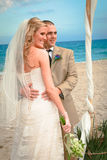 Beach Wedding: Bride and Groom Royalty Free Stock Images
