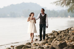 Beach wedding with bride, groom on the beach Royalty Free Stock Images