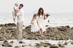 Beach wedding with bride, groom, and children Royalty Free Stock Photo