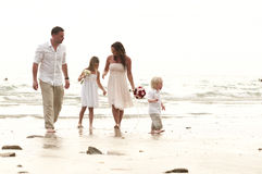 Beach wedding with bride, groom, and children Royalty Free Stock Images