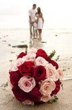 Beach wedding with bride, groom, and children