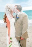 Beach Wedding: Bride and Groom Kiss Stock Photo