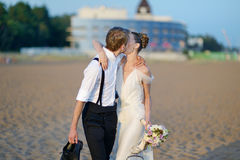 Beach wedding: bride and groom by the sea Royalty Free Stock Photos