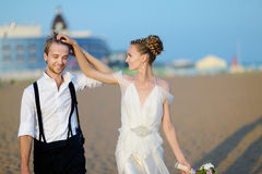 Beach wedding: bride and groom by the sea Stock Photo