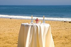 Beach wedding ceremony. A view a vase of two colors of sand that has been mixed together by a bride and groom as part of a beach wedding ceremony Royalty Free Stock Images