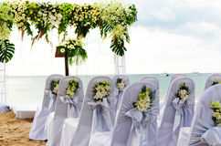 Beach wedding. Chairs and altar arranged on beach for wedding with sea in the background royalty free stock photos