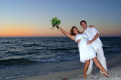 Beach wedding couple celebrate Stock Photography