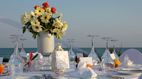 Beach Wedding Decor Table Setting and Flowers. Outdoor Table Setting at Wedding Reception by the Sea. Wedding Table Setting Stock Photo
